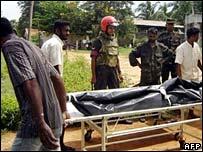 Sri Lankan troops prepare to hand over rebel bodies in Vavuniya in October