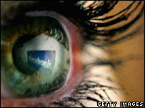 Facebook logo reflected in eye, Getty