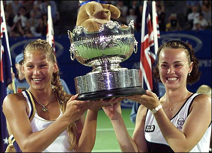 Martina Hingis and Anna Kournikova lifting the 1999 Australian Open doubles