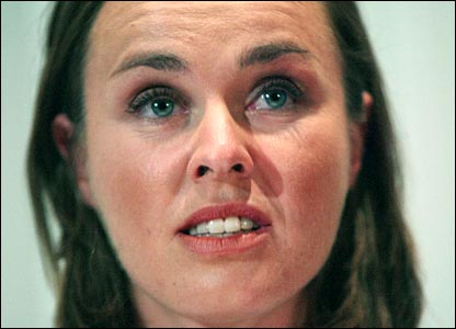 Martina Hingis shows the strain as she confirms her retirement at the age of 27