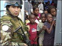 A UN soldier stands guard in front of a school on 1 November 2007 in Port-au-Prince, Haiti