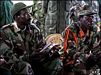 LRA leader Joseph Kony (l) and his no 2 Vincent Otti (r) in DRC (File photo)