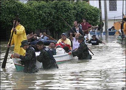 People evacuating in boats