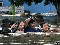 People up to their chests in flood water