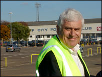 Peter Ridsdale with Ninian Park behind him