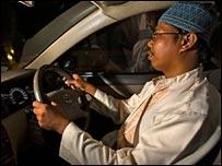 Bani driving his car