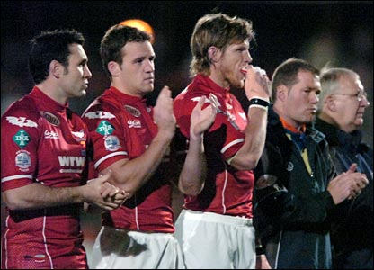 The silence at Stradey Park gives way to applause in memory of Wales rugby great 'Grav'