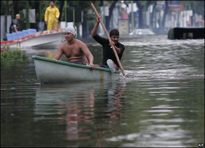 A boat moves through floodwaters in Villahermosa, Mexico, Nov. 2 2007