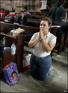 A woman prays at a church where residents have taken shelter after evacuating flooded areas in Villahermosa, Mexico, Nov. 2, 2007
