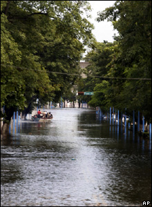 A boat moves through floodwaters in Villahermosa, Mexico, Nov. 2, 2007