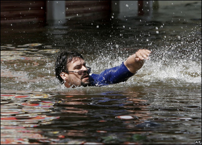 A man swims in flood waters in Villahermosa, Mexico, Nov. 2, 2007