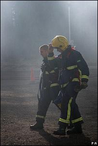 Firefighters near the scene of the warehouse blaze