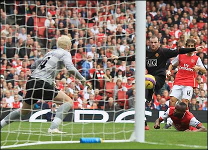 Rooney and Gallas watch as ball heads towards the net