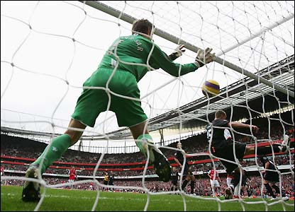 Edwin Van der Sar and Nemanja Vidic try unsuccessfully to keep Gallas's shot out