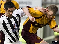 St Mirren's Gary Mason tussles with Motherwell's David Clarkson