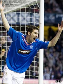 Carlos Cuellar celebrates scoring the second goal against Inverness