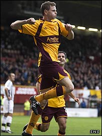 Chris Porter celebrates scoring the opener for Motherwell