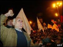 Georgian opposition supporters shout slogans in front of the parliament building in the center of Tbilisi, 3 November 2007