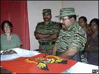 Rebel leader Velupillai Prabhakaran (R) mourns SP Thamilselvan