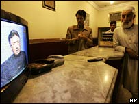 Men watch Gen Musharraf's TV address in Rawalpindi hotel