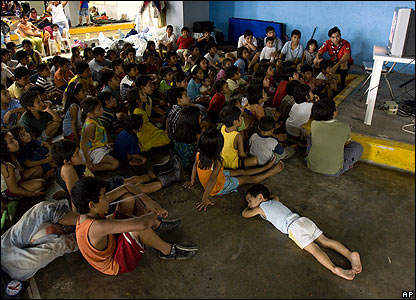 Children watch TV in a shelter on 3 November after being evacuated from Villahermosa