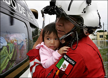 A helicopter crewman evacuates a flood victim in Villahermosa on 3 November