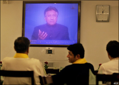 Pakistanis watch President Musharraf announcing the introduction of emergency rule