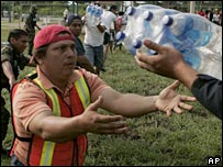 Volunteers carry bottles of water for flood victims in Villahermosa
