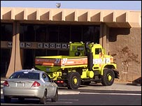 Race competitor TerraMax, a dumper truck, drives into an empty building