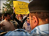 A policeman monitors an anti-Musharraf protest in Islamabad on 4 November