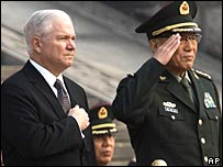 Robert Gates (R) and his counterpart Cao Gangchuan during a military parade, 05/11