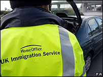 An UK immigration officer checks vehicles heading for passport control (Photo: Gareth Fuller/PA Wire)