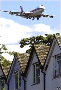 Plane flies over homes