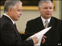 Poland's PM Jaroslaw Kaczynski, right, hands his resignation documents to President Lech Kaczynski in Warsaw. Nov 5, 2007