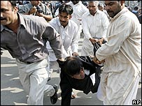 A lawyer is detained by police in Lahore, 5/11/07