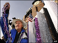 A vendor sells beads outside Coors Field in Denver a game in the baseball World Series