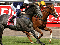 Efficient with jockey Michael Rodd (L) on board streaks home to win the Melbourne Cup ahead of Purple Moon, ridden by Damien Oliver.