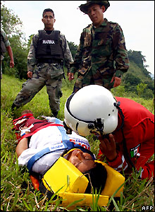 First aid is given to a woman at San Juan Grijalva