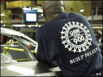 UAW member works on a Ford Focus at a Ford factory in Michigan 