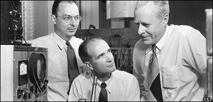 John Bardeen (left), William Shockley (seated) and Walter  Brattain (right)