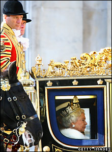 The Queen looks out of carriage travelling from the State Opening of Parliament