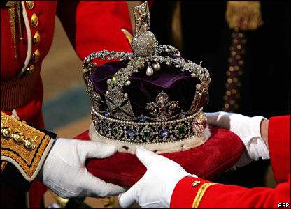 The crown to be worn by Queen Elizabeth II arrives at the Sovereign Entrance of the House of Lords