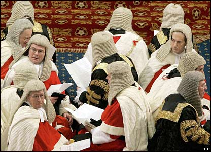 Law Lords sit on the cross benches as they wait in the House of Lords