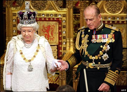 The Queen holds hands with the Duke of Edinburgh