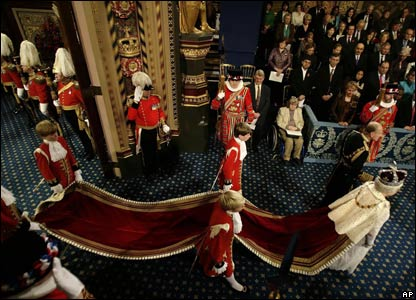 The Queen and Prince Philip pass through the Royal Gallery at the House of Lords