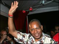 Trinidad's Prime Minister Patrick Manning raises his hand during a victory rally