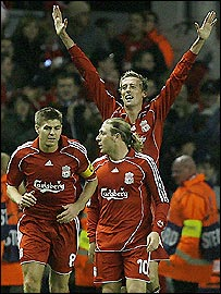 Liverpool striker Peter Crouch (back) celebrates his goal as he towers above Steve Gerrard (left) and Andriy Voronin