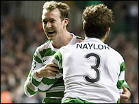 Lee Naylor (number 3) congratulates Celtic goalscorer Aiden McGeady