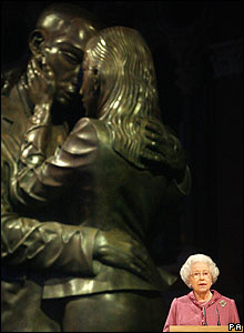 The Queen with the Meeting Place sculpture in the background