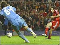 Yossi Benayoun slots ho9me in the 8-0 win over Besiktas as he helps Liverpool to a record Champions League win